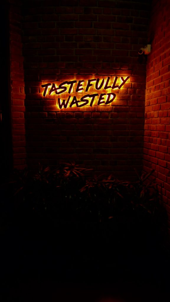 tastefully wasted neon signage