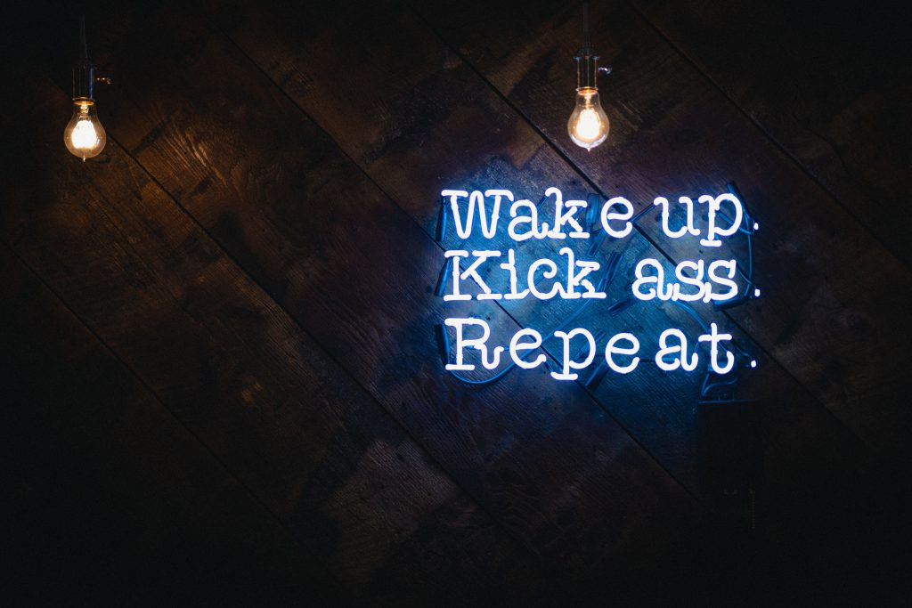 blue wake up kick ass repeat neon sign